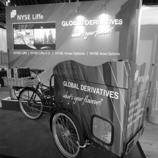 Wrapped branded tricycle with printed foamex back wall